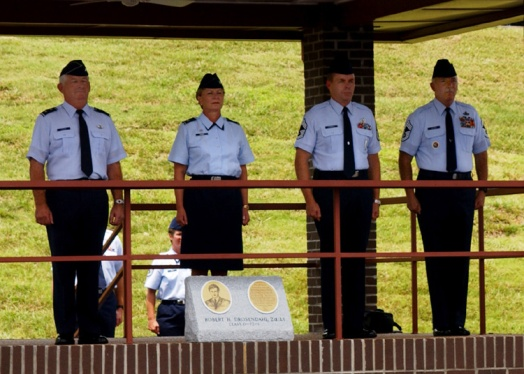 Air Guard training and education center leaders, Col. Barbara Eager, commander, Chief Master Sgt. Joseph Thornell, the incomming commandant, and Chief Master Sgt. Arthur Hafner, the outgoing commandant, stand at attention during the July 16, 2003, change of commandant and graduation event at the parade field on McGhee Tyson Air Guard Base. (U.S. Air National Guard file photo)
