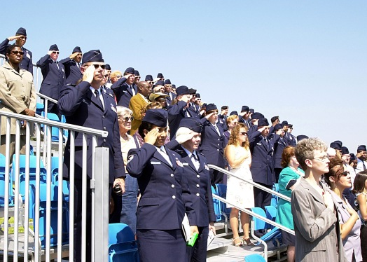Guests stand for the National Anthem during the NCO Academy graduation ceremony, Sept. 17, 2003, for Class 03-5 on the parade field at the Air Guard's training and educaiton center in East Tennessee.,
