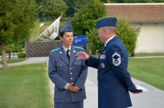 MCGHEE TYSON AIR NATIONAL GUARD BASE, Tenn. - Sergeant Yordanka S. Petrova-Angelova with the Bulgarian air force talks with U.S. Air Force Senior Master Sgt. Andrew Traugot, director of education, Satellite EPME, here August 15, 2013, on the campus of the I.G. Brown Training and Education Center. Petrova-Angelova graduated from the U.S. Air Force Noncommissioned Officer Academy instructed by the Paul H. Lankford Enlisted PME Center. She and Bulgarian Corporal Stoyko V. Stoykov, who attended Airman Leadership School at around the same time, completed the leadership education this summer as part of relations built through the Tennessee National Guard State Partnership Program. (U.S. Air National Guard photo by Master Sgt. Kurt Skoglund/Released)