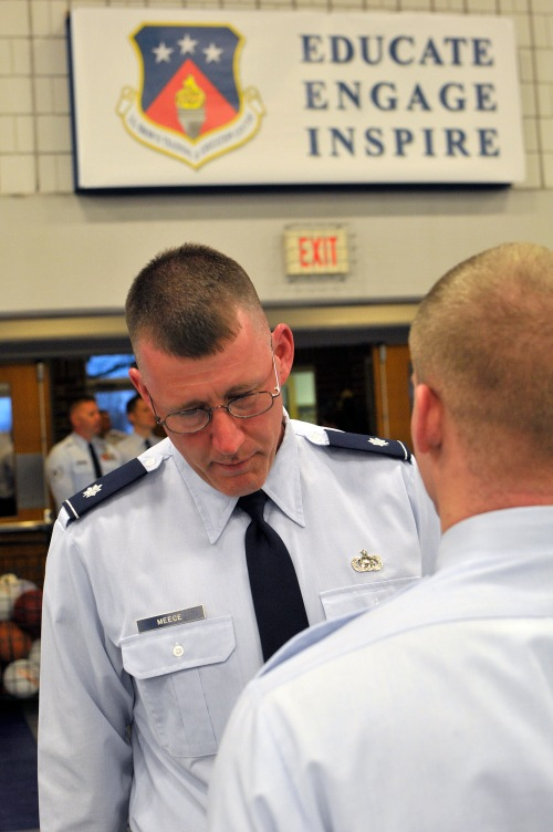 MCGHEE TYSON AIR NATIONAL GUARD BASE, Tenn. - Lt. Col. David Meece, deputy commander, inspects uniforms during the commandant's inspection for Airman leadership school March 30, 2015, at the I.G. Brown Training and Education Center. Students undergo three uniform inspections during their weeks of leadership studies. (U.S. Air National Guard photo by Master Sgt. Mike R. Smith/Released)