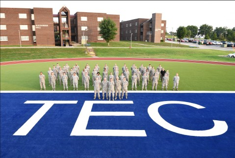 The Air National Guard's I.G. Brown Training and Education Center staff and faculty stand on the end zone of the athletic field, July 17, 2018, at McGhee Tyson Air National Guard Base in East Tennessee. (U.S. Air National Guard photo/Master sgt. Jerry Harlan)