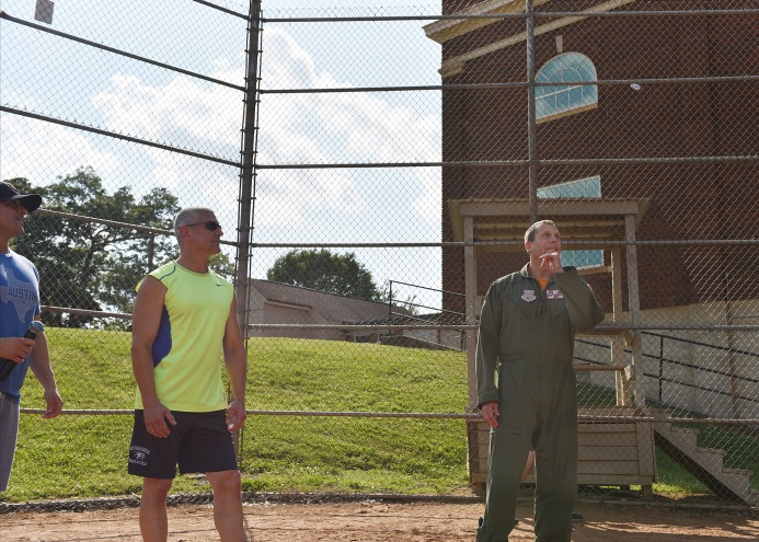 The Commander of the Tennessee Air National Guard's 134th Air Refueling Wing, U.S. Air Force Col. Martin L. Hartley, Jr. (right), and Air National Guard education center Deputy Commander, U.S. Air Force Lt. Col. John Capra, toss a coin to decide which team will bat in a unit Vs. unit softball game, May 17, 2019, at Springbrook Park in Alcoa, Tennessee. Airmen from both groups serve on McGhee Tyson Air National Guard Base. They and their families played two games as a means to promote camaraderie and team building. (U.S. Air National Guard Base/Master Sgt. Mike R. Smith)